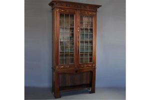 Thumb arts and crafts bookcase with motto judge not a book by the cover 0