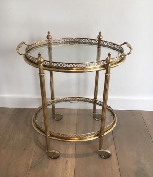 In The Style Of Maison Jansen. Neoclassicale Oval Brass Trolley With Removable Trays. French. Circa 1940