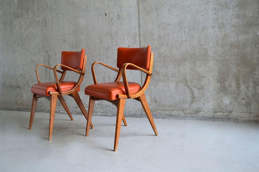 Pair Of 1960's Ben Chairs In Fabulous Orange Vinyl Upholstery.