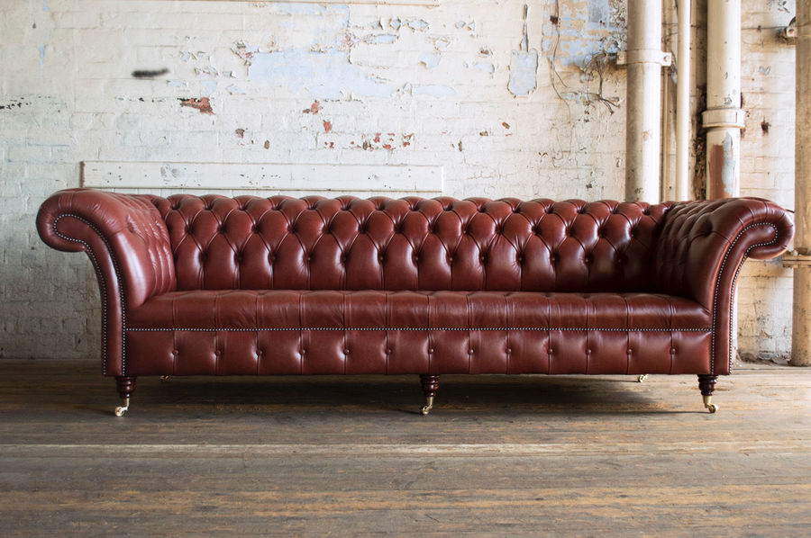 Antique Chesterfield. Recovered Reworked Antique Chestnut Red Leather Sofa. 4 Seater.